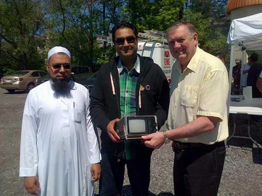 Imam Badat, Masjid Bilal Chairman Tahawar Mahmood Rana, and City Councillor Bob Monette during the mosque's e-waste recycling drive.