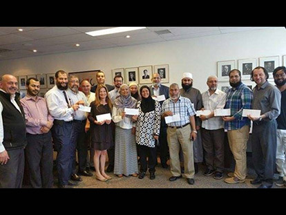 Members of the United Muslim Organizations of Ottawa-Gatineau delivering donations to Canadian Red Cross Headquarters