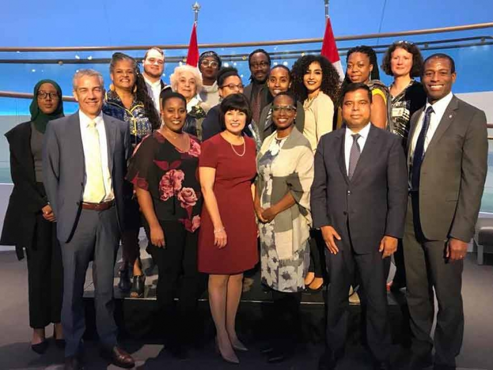 "Habon Ali with Canadian Members of Parliament and members of the Public Health Agency of Canada at the launch of the ""Mental Health of Black Canadians Fund."""