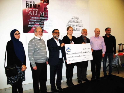 Members of the London Muslim Mosque present a donation to the London Health Sciences Foundation for the education of a doctor from Gaza.