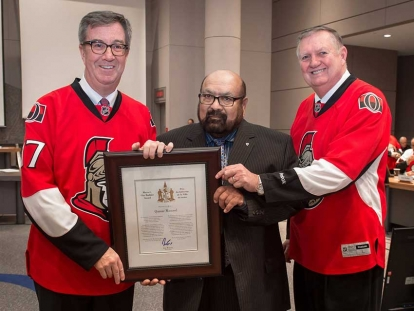 City Builder Award winner Qamar Masood with Mayor Jim Watson and Orléans Ward Councillor Bob Monette.