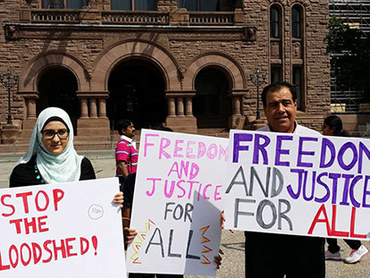 Izzeldin Abuelaish and his daughter Shatha at the July 15th vigil in Toronto