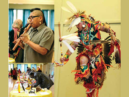Jason Mullins dances in traditional Cherokee regalia. Mi'kmaq Artist Thomas Clair plays flute. Guests views auction items donated by Aboriginal organizations and artists.