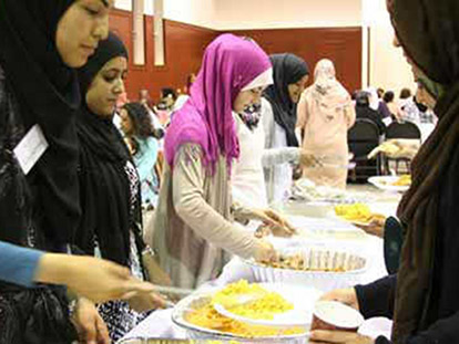 Guests at a community dinner hosted by the Amal Center for Women in Montreal.