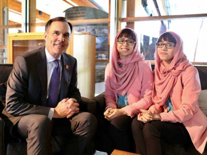 Maryam and Nivaal with Bill Morneau, Canada's Finance Minister, at the G7 Summit