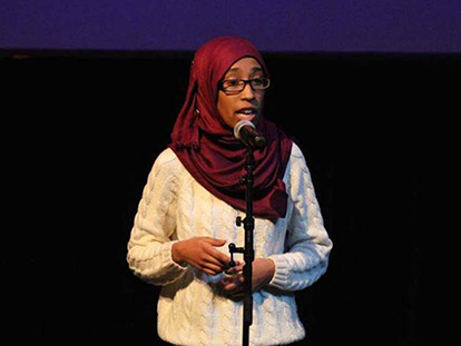 "Roua Aljied performing ""Looking Over Her Shoulder"" at the Impact of Family Violence Conference in Ottawa."