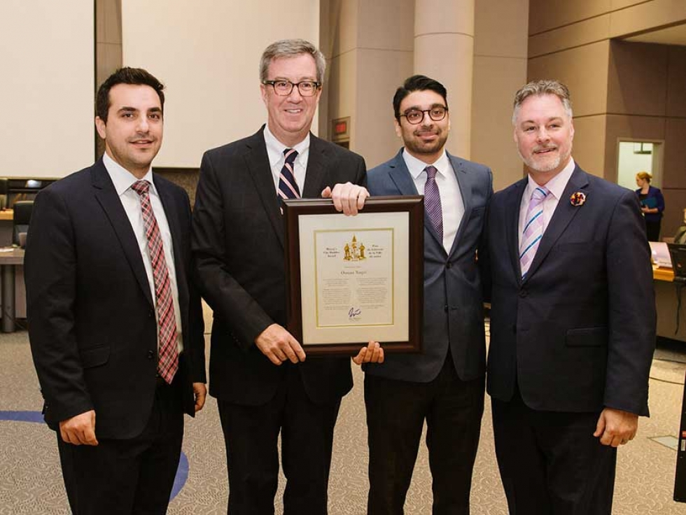 Osman Naqvi receiving Ottawa's City Builder Award from Mayor Jim Watson and City Councillors Mark Taylor and Michael Qaqish