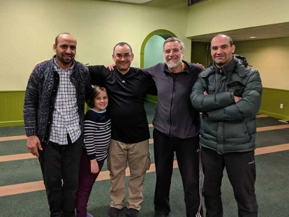 Ryan and Elisabeth with new friends Group picture with three new friends Saïd, Hakim and Ahmed at the Centre Culturel Islamique de Québec.