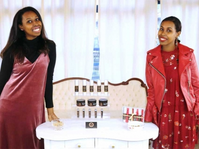 Somali Canadian sisters Ilhan and Iman show off some of their family's Rasmi Natural Skin Care products in Vancouver.
