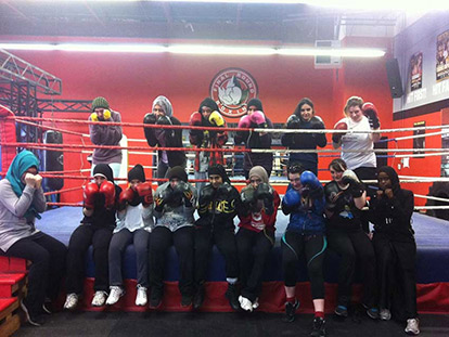 "Aaida ""Mombasa"" Mamuji with participants in the Muslim Women's Boxing Program at Final Round."