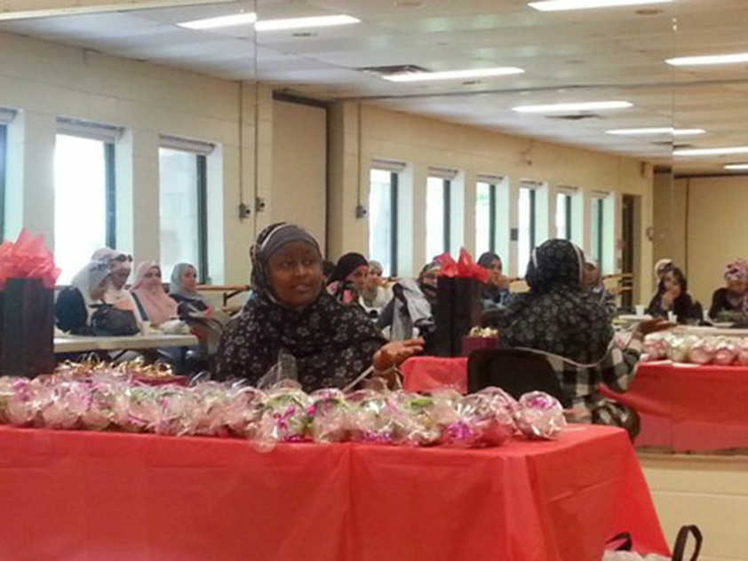 Amina Umuzayire discusses her charity with local Muslims.
