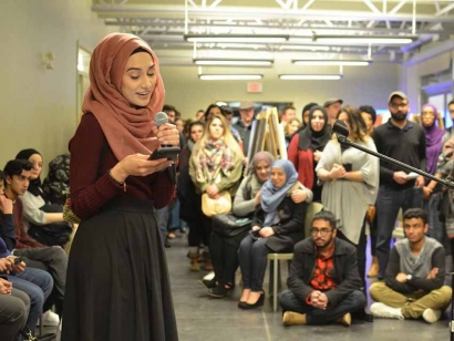 Spoken word poet  Maha Malik performing at the annual Muslim Art Movement event organized by the Western Muslim Initiative in Calgary, Alberta.